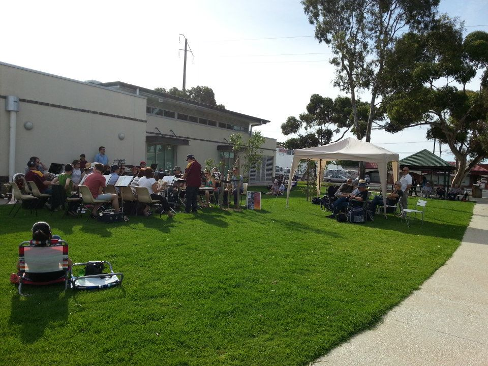 The band and its audience at the Klemzig Reserve, behind the Community Hall